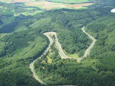 Germany~ Nurburgring. The most fun I've ever had driving. More fun than any ride at Disneyland.