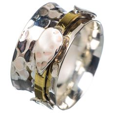 "Sterling Silver two tone spinner ring. DETAILS: * Size 7 1/2 * 4.3 g total weight * SOLID .925 Sterling Silver * Stamped .925 * Measures approximately 1/2"" wide Spinner Rings are also called Tibetan w"