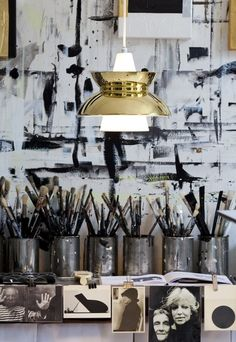 monochrome art work space; would love to transform my old tins into paint brush holders.