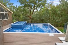 Utilising space is key, this out of ground concrete pool was built almost 2 meters above natural ground level, turning an unused space into a great pool, spa & decking combo for the whole family to use. Modwood Decking, Concrete Pool, Pool Spa, In Ground Pools, How To Level Ground, Turning, Tiles, Key, Space