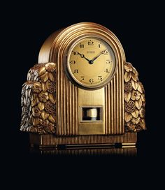 """1931, """"Gilt wood"""" Atmos 1.   Found on the """"Atmos"""" board of the official Jaeger-LeCoultre Pinterest page."""