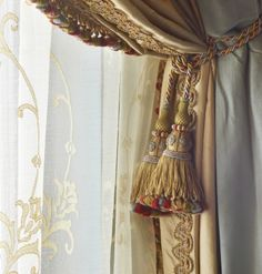 Layered with Sheer Embroidered Draperies, Braided Trim on Panel with Decorative tassel Hold Back
