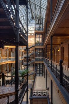 """The Bradbury Building """"is the oldest commercial building remaining in the central city and one of Los Angeles' unique treasures. Still splendid more than 100 years after its 1893 opening, its magical light-filled Victorian court, open cage elevators, marble stairs, and ornate iron railings make this one of downtown's most photographed icons."""" Los Angeles Conservancy #architecture"""