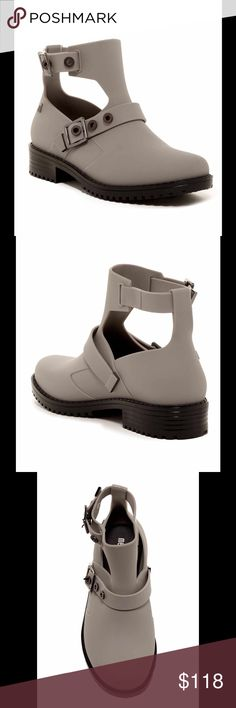 🎉POSH PARTY🎉 Melissa Footwear Grey Boot Round toe, ankle cut-out detail, adjustable buckle ankle and shaft strap, lug sole. PVC upper and sole.  Melissa Footwear Shoes Ankle Boots & Booties