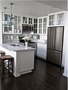 white kitchen with blue pendants