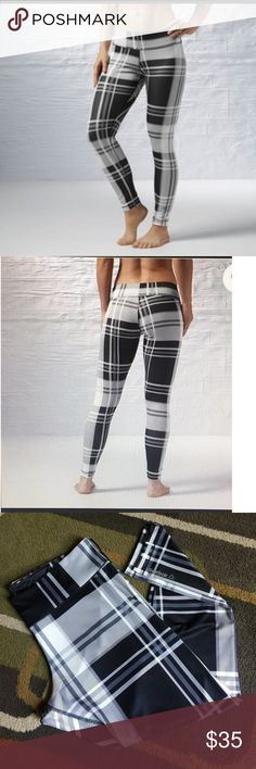 """Reebok yoga pants💘 Black and gray plaid with light pink highlights💘 material is 91% polyester 9% spandex💘lying flat waist measures 17"""" 💘 inseam is approx 28.5"""" Reebok Pants"""