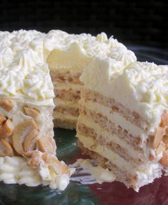 Sans Rival:Crisp meringue-cashew nut wafers layered with fresh buttercream icing and more chopped cashews