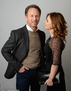 Smitten: Geri was seen looking lovingly at Christian as they posed together for the cameras