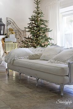 vintage French tufted sofa in a christmas decor/shabbyfufublog.com