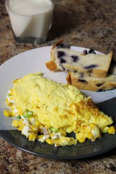 Wake up with this savory omelet stuffed with sweet corn, creamy goat cheese, and fresh green onion. Easy enough to make even on a weekday morning. Egg Recipes, Brunch Recipes, Chocolate Beer, Pie Kitchen, Bowl Of Cereal, Sweet Corn, Goat Cheese, Goats, Cravings