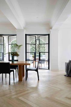 Steel framed doors in luxurious large dining room. Minimalism Interior, Spanish Home Decor, Bungalow Interiors, Spanish Style Home, House Rooms, Home Room Design, Home, Melbourne House, Minimal Modern Design