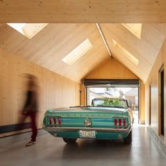 Motiv Architects created the project to house the owner's restored vintage Mustang and to serve as a workshop for them to manage their industrial bag and belt fabrication company. Building A Garage, Vintage Mustang, Studio Build, Cedar Siding, Wood Structure, Western Red Cedar, Dezeen, Building Materials, Interior Design Inspiration