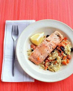 Combine uncooked couscous with sliced carrots, slivered almonds, raisins, fresh mint, water, and a bit of olive oil to create a Moroccan-inspired pilaf that bakes in the same pan as the salmon for a delicious, one-dish dinner.