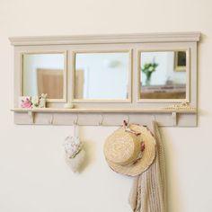 Hallway storage - hooks + shelf + mirror. The bottom shelf needs to be deeper though, it's fairly useless as is.
