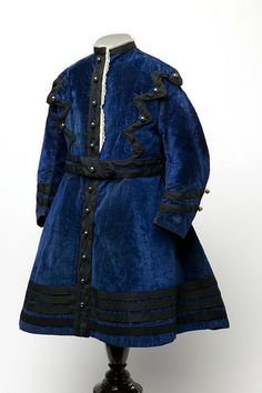 Little boy's blue velvet dress with black trim, English, 1868.
