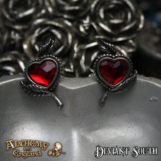 Alchemy Gothic E338 Love's Blossom Studs Stud Earrings (pair)  A pair of red Swarovski crystal hearts set into foliate pewter mounts; with surgical steel ear posts.