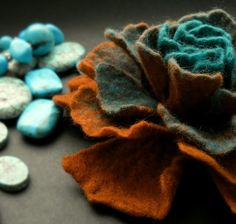 http://www.etsy.com/listing/61702591/copper-turquoise-felt-flower-brooch. Love the color combination here.