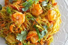 A popular dish on any Chinese take-out menu is Singapore Noodles, or Singapore Mei Fun. Singapore noodles recipe are rice noodles (mai fun) and yellow curry