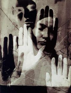 Man Ray, Dora Maar 1936 | This image seems like the woman is stuck behind a mirror, trying to fight her way out, it's like saying the way women are looked at is wrong and there's a deeper meaning to this image which is why I'm so attracted to it.