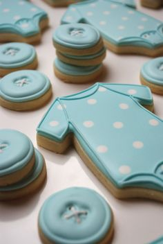 These classic onesie cookies are decorated in a soft baby blue with white polka dots They are accompanied by the sweetest little button cookies in a matching shade of blue If you would like a different colour scheme for this collection mention your choice in the comments section when checking out