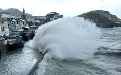 Telegraph photographer Paul Grover captures the moment a huge wave crashes into the sea wall at Ilfracombe, North Devon