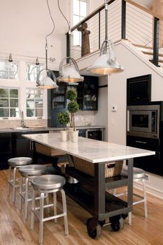 Gorgeous kitchen! Love these light fixtures and retro stools.
