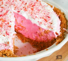 Pink Lemonade Pie  1 graham cracker crust {recipe here}  1 ~ 12 ounce can frozen pink lemonade {thawed}  1 large 16 ounce container Cool Whip  1 can sweetened condensed milk  PINK food coloring  sweetened flakey coconut {optional}
