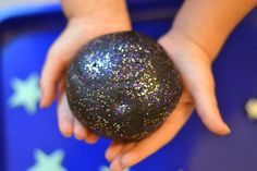 GALAXY DOUGH is super smooth, ultra sparkly, & really stretchy.  This no cook recipe takes seconds to make & is so FUN!  My kids played four hours!