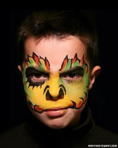 Halloween Face Painting | Martha Stewart Living - This mean monster costume is all in the face. Use colored face paint to create a horrifying hollow look with black tendrils.