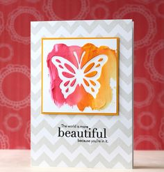 PTI~Life is Beautiful by L. Bassen, used ink-colored embossing paste with butterfly diecuts...