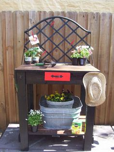 Combine pallet wood with a daybed frame to create a cheerful potting table.