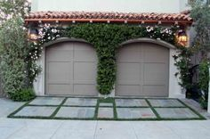Sometimes just outlining one shape helps to create yet another shape. In this small auto court, the simple idea of planting a 2-inch ground cover grid around the pavers illustrates the positive-negative pattern. And similarly, by planting a lush Cecile Brunner climbing rose around the two arched garage doors, yet another attractive positive-negative form is created.