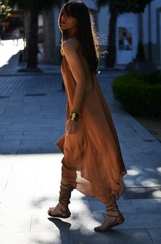 Absolutely in love with this 'all nude' monochromatic 'street style' summer outfit:floaty long dress with large front pockets & low cut on back + multi-buckle detail flat gladiator sandals + envelope clutch + gold-tone cuff.Sexy in a comfy way! P.S.Bright shades on lips and pedi give a dose of color to the look!