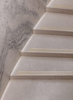 Harrods Fine Watches department features a sweeping marble staircase
