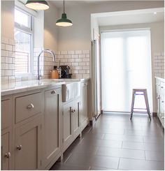 notice shaker cabinets and tile floor -- big rectangles, narrow grout