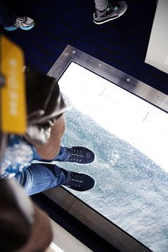 From where I stand: 10 decks below me! Quantum of the Seas' elevators feature glass floors so you can see the Royal Esplanade down below.
