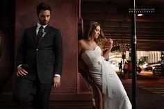 Dramatic fashion style posed wedding couple