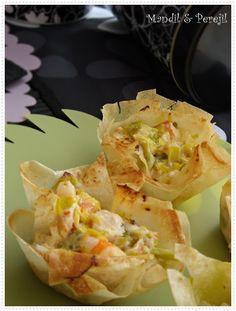 Las cestitas de hoy están inspiradas en un aperitivo que vi en el blog  LAS RECETAS DE MAMÁ . En lugar de hacer saquitos como nos pro...