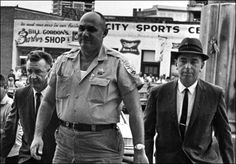Sheriff Lawrence Rainey being escorted by two FBI agents to the Federal Court house in Meridian, Mississippi; October 1964.
