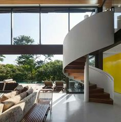 Architect Fernanda Marques has designed the Limantos Residence located in São Paulo, Brazil. Fernanda Marques gives the home a warm and welcoming feeling w Spiral Stairs Design, Staircase Design, Staircase Ideas, Stair Design, Stairs In Living Room, House Stairs, Exterior Design, Interior And Exterior, Concrete Stairs
