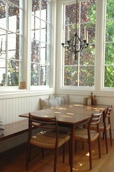 There is something so friendly and welcoming about the clean lines, simple wood and heavenly windows... what a great place to gather with friends and family.