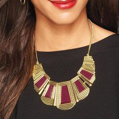 Seek Triumph Necklace   Avon. Only $16.99 Now!   Antique-esque and beautiful! This necklace is an inspired antique look with an antique goldtone collar necklace with red plastic geometric stones on metal plates.