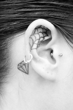 spider web ear tattoo