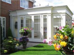 Full height glazing allows this orangery maximum views of the garden. In Chelmsford this classically refined wood building links the garden and home. Orangery Conservatory, Conservatory Design, Tudor House Exterior, Garden Room Extensions, Kitchen Extensions, Orangery Extension, Four Seasons Room, Old Stone Houses, Porch Addition