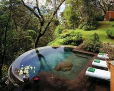 A small infinity pool or spa.  If you have a view like that, you should have a pool/spa like this, right?