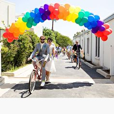 Brides.com: All Things Rainbow. Embrace the playful, kitschy atmosphere inherent to a rainbow wedding by floating a colorful balloon arch over the entrance to your reception venue. (Traveling from the ceremony by bike is optional.)