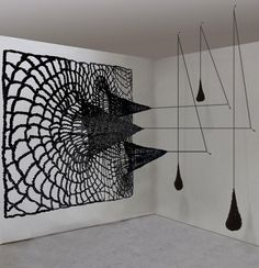 Alisa Dworsky  http://www.alisadworsky.com/  think of the black dots from the animation with the fingerweaving