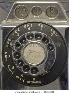 Rotary dial pay phone. Operators could tell how much money you deposited by the tone that each type of coin made