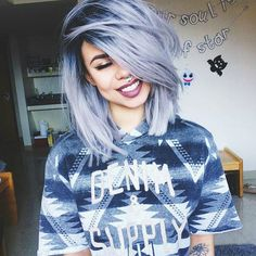 Cute blue grey dyed hairstyle with dark roots -