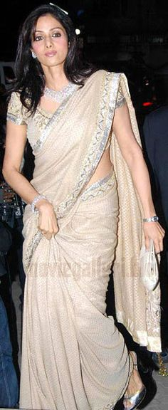 Sridevi looks half her age in a lovely light saree.